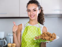 Woman posing with plate of deep-fried kroketten Royalty Free Stock Photography