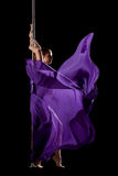 Woman posing in pole dance with fabric isolated Royalty Free Stock Photography