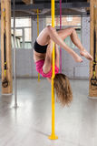 Woman posing on a pole Stock Photography