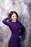 Woman posing in purple dress. Royalty Free Stock Photo