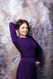 Woman posing in purple dress. Stock Images