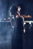 Woman posing in the rain. Royalty Free Stock Image