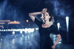 Woman posing in the rain. Royalty Free Stock Photo