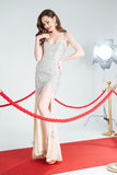 Woman posing on red carpet Stock Photography