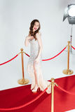 Woman posing on red carpet Royalty Free Stock Photography