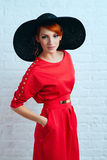 Woman posing in red dress Royalty Free Stock Images