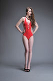 Woman posing in red swimsuit Royalty Free Stock Photography
