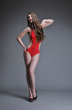 Woman posing in red swimsuit Stock Image