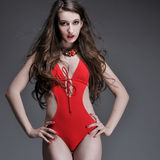 Woman posing in red swimsuit Stock Images