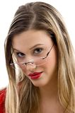 Woman posing in red and wearing eyeglasses Royalty Free Stock Photography