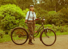 Woman posing with retro bicycle in the park Stock Image