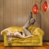 Woman posing on retro couch. Stock Image