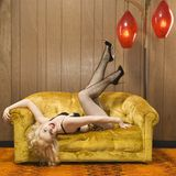 Woman posing on retro couch. Stock Photos