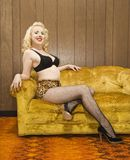 Woman posing on retro couch. Stock Images