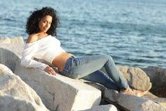 Woman posing on the rocks Stock Photography