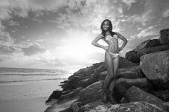 Woman posing on the rocks Stock Image