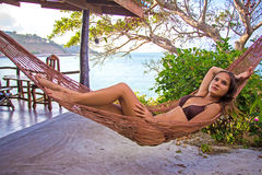 Woman posing at romantic hammock in private house Royalty Free Stock Images