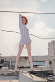 Woman posing on the roof Royalty Free Stock Photography
