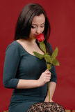 Woman posing with rose Stock Image