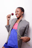 Woman posing with a rose Royalty Free Stock Photo
