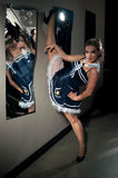 Woman posing in sailor costume. Young beautiful woman posing in sailor costume near the mirror Royalty Free Stock Photo