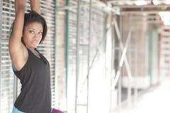 Woman posing by scaffolding Stock Photo