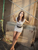 Woman posing by scaffolding Stock Photo