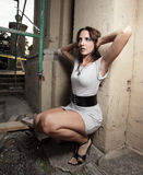 Woman posing by scaffolding Stock Photography