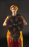 Woman posing with shield - arabia theme Royalty Free Stock Photography