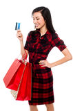 Woman posing with shopping bags and debit card Stock Photo