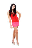 Woman posing in short skirt. Beautiful woman posing in short skirt. Isolated over white background Stock Photography