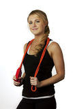 Woman posing with skipping rope Royalty Free Stock Image