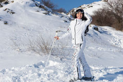 Woman Posing on Skis on Snow Covered Mountain Stock Photography