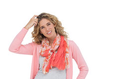 Woman posing and smiling while scratching her head Stock Photography