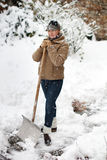 Woman posing with snow shovel Stock Photo