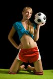 Woman posing with soccer ball Royalty Free Stock Photos