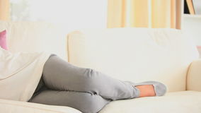 Woman posing on a sofa stock video footage