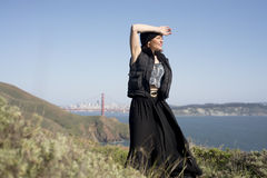 Woman posing on some headlands Royalty Free Stock Photos