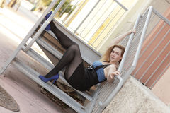 Woman posing on a staircase. Attractive woman posing on a staircase Royalty Free Stock Photography