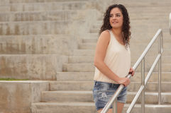 Woman posing on a staircase Royalty Free Stock Photography