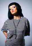 Woman posing in a striped top Stock Image