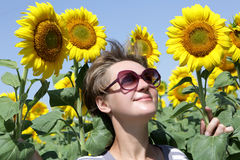 Woman posing with sunflowers Stock Images