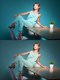 Woman posing on the table. Stock Photo
