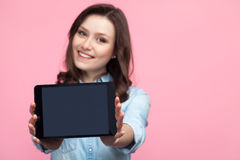 Woman posing with tablet Stock Image