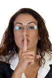 Woman posing to keep silence Stock Image