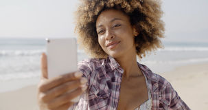 Woman Posing To Take A Selfie On The Beach Stock Image