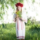Woman posing in traditional ukrainian costume Stock Photo
