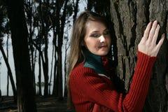 Woman posing at tree Royalty Free Stock Photos