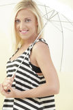 Woman posing with an umbrella Royalty Free Stock Image
