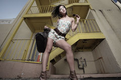 Woman posing by an urban setting Royalty Free Stock Images